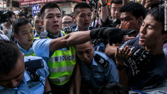 HONG KONG - NOVEMBER 25: Police clash with protesters as they try to clear the street after agents authorized by bailiff's removed barricades on Argyle Street in Mongkok district on November 25, 2014 in Hong Kong. The Mong Kok protest site is scheduled for clearance by baliffs this week after Hong Kong's high court authorized police to arrest protesters who obstruct bailiffs on the three interim restraining orders.  (Photo by Chris McGrath/Getty Images)