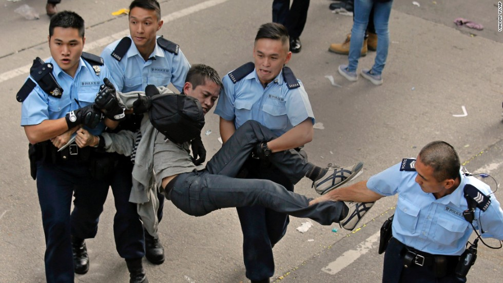 A protester is carried away by police officers on November 25. Hong Kong's high court authorized police to arrest protesters who obstruct clearance of the area.