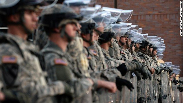 National Guard troops secure the police station in Ferguson, Missouri, on November 25, 2014 a day after violent protests and looting following the grand jury decision in the fatal shooting of a 18-year-old black teenager Michael Brown. Missouri Governor Jay Nixon told reporters that a total of 2,200 National Guard troops were being deployed in the St Louis area on November 25-- triple the 700 sent out the night before. Looting erupted and businesses were set ablaze in the St Louis suburb overnight Monday, after a grand jury opted not to indict white police officer Darren Wilson for the fatal shooting of unarmed black teenager Michael Brown in August. AFP PHOTO/Jewel Samad        (Photo credit should read JEWEL SAMAD/AFP/Getty Images)