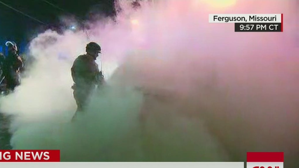 Protesters torch police car in another tense night in Ferguson