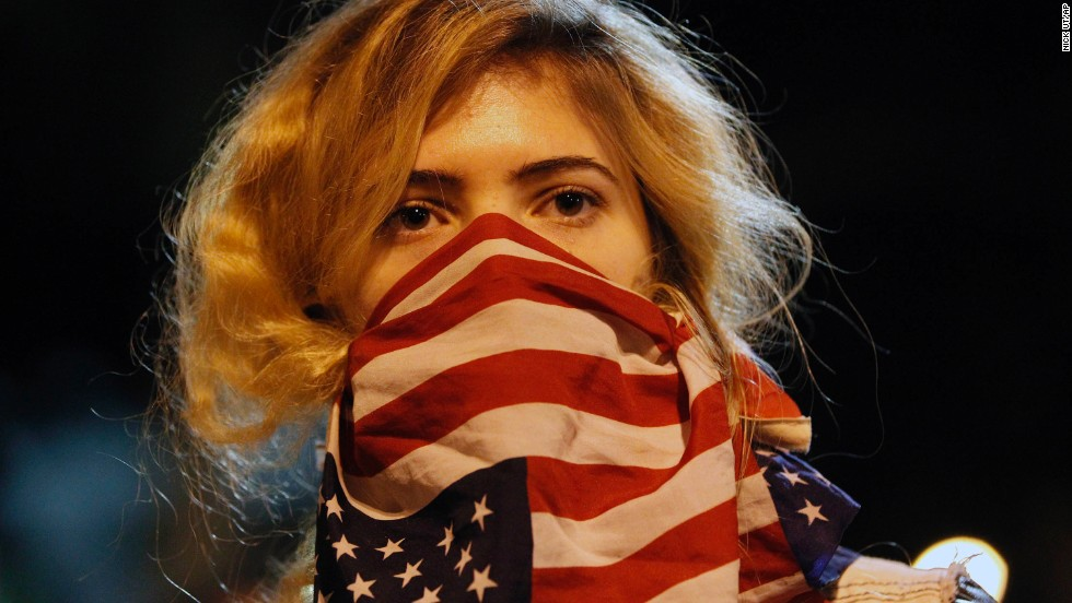 A woman joins a rally near Los Angeles police headquarters on November 25.