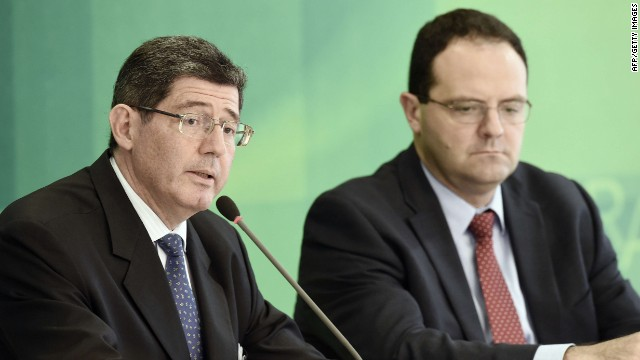 The new ministers of Finance, Joaquim Levy (R) and Planning, Nelson Barbosa (L) during a press conference at Planalto Palace in Brasilia, on November 27, 2014. Levy will replace Guido Mantega and Barbosa will replace Mirian Belchior respectively. AFP PHOTO/EVARISTO SAEVARISTO SA/AFP/Getty Images
