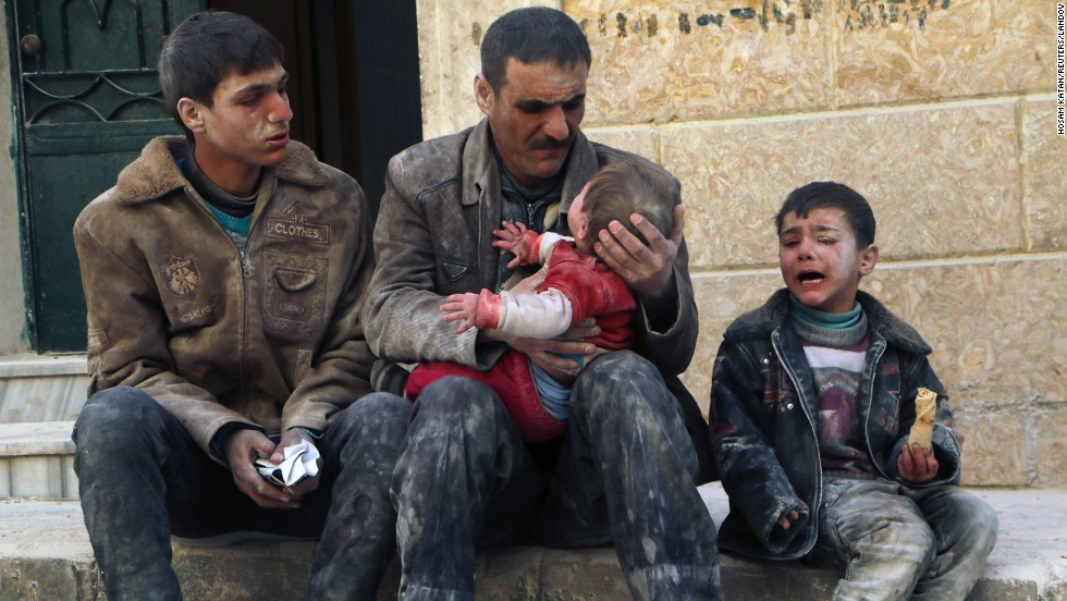 <strong>February 14:</strong> A man in Aleppo, Syria, holds a baby who survived what activists say was an airstrike by forces loyal to Syrian President Bashar al-Assad. The United Nations estimates more than 190,000 people have been killed in Syria since an uprising in March 2011 spiraled into civil war.