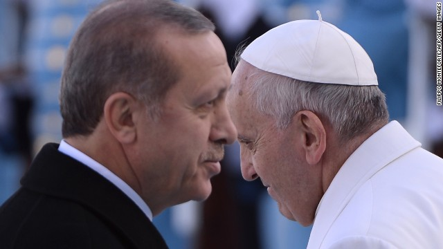Pope Francis (R) is welcomed by Turkish President Recep Tayyip Erdogan (L) as he arrives for a meeting at the presidential palace in Ankara as part of a three day visit in Turkey on November 28, 2014