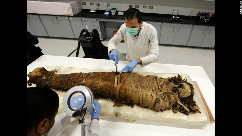 <strong>March 17:</strong> Conservators at Egypt's Grand Museum, just outside of Cairo, clean a female mummy that dates to the Pharaonic Late Period between 712-323 B.C.