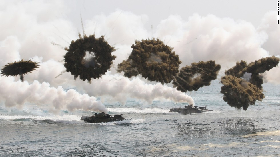 <strong>March 31:</strong> South Korean watercraft travel through smoke screens during a military exercise with U.S. forces in Pohang, South Korea.