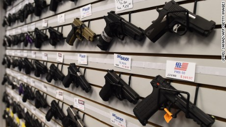 Caption:Handguns are displayed at the Ultimate Defense Firing Range and Training Center in St Peters, Missouri, some 20 miles (32 kilometers) west of Ferguson, on November 26, 2014. Paul Bastean, owner of the range, told AFP that business had grown as a result of anxiety about reaction to the jury announcement in the shooting death of 18-year-old Michael Brown. Typical sales of five to seven guns a day have risen to 20 to 30 in the last week, while gun-handling courses for November and December are fast selling out. Violence erupted in the St Louis, Missouri suburb for a second night on November 25 over the decision by a grand jury not to prosecute a white police officer for shooting dead Brown, an unarmed black teenager. AFP PHOTO/Jewel Samad (Photo credit should read JEWEL SAMAD/AFP/Getty Images)