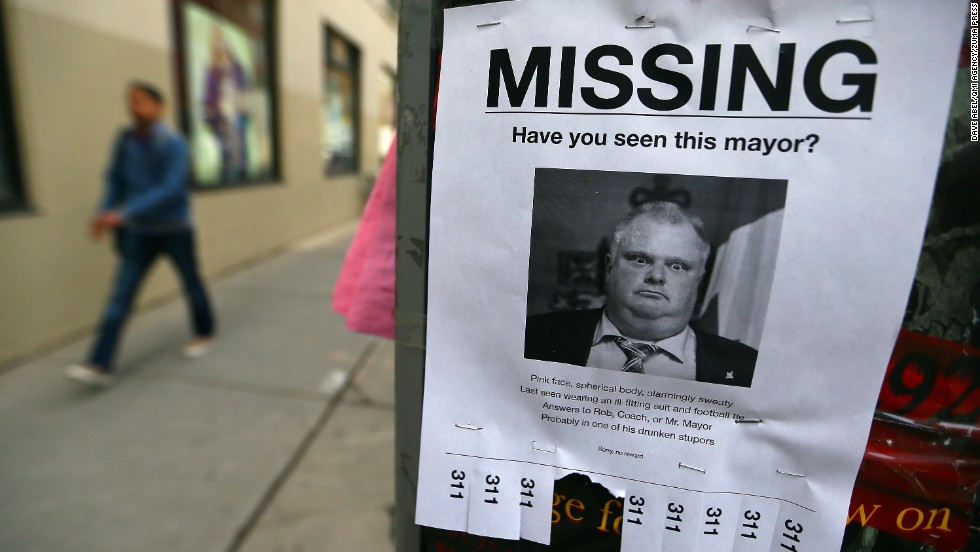 "<strong>May 7:</strong> Toronto Mayor Rob Ford is seen on a mock ""missing person"" poster in Toronto. Hours after a local newspaper <a href=""http://www.cnn.com/2013/11/15/politics/gallery/rob-ford-controversy/index.html"">reported on a new video that allegedly showed Ford smoking crack cocaine,</a> the mayor announced that he would be taking a break from his duties and his re-election campaign to seek help for alcohol abuse. Later in the year, after the discovery of an abdominal tumor, <a href=""http://www.cnn.com/2014/09/12/world/toronto-mayor-ford-withdraws/"">he decided not to seek re-election.</a>"