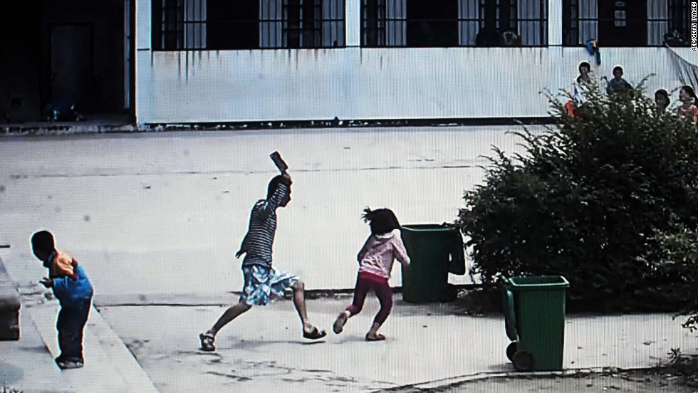 "<strong>May 20:</strong> This picture, taken from security camera video, shows a knife-wielding attacker going on a rampage at a primary school in Macheng, China. Eight students were injured in the attack, <a href=""http://www.scmp.com/news/china/article/1516758/children-attacked-knifeman-hubei-school"" target=""_blank"">according to the South China Morning Post</a>."