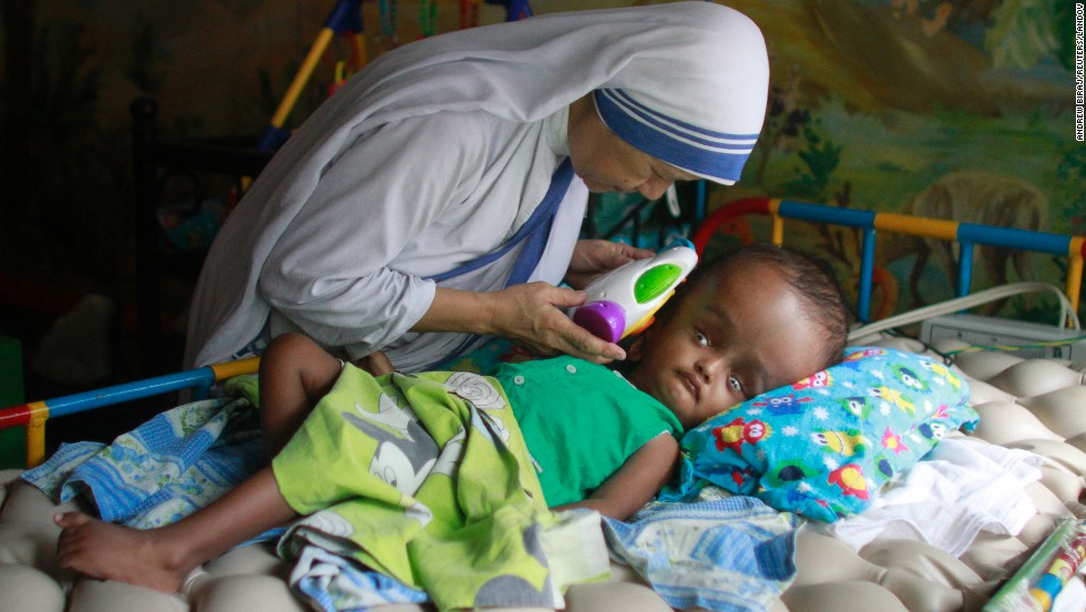 <strong>May 11:</strong> Sister Maricor from the Missionaries of Charity spends a moment with John, a 1-year-old with hydrocephalus, at an orphanage in Dhaka, Bangladesh. Hydrocephalus is characterized by an excessive accumulation of fluid in the brain.