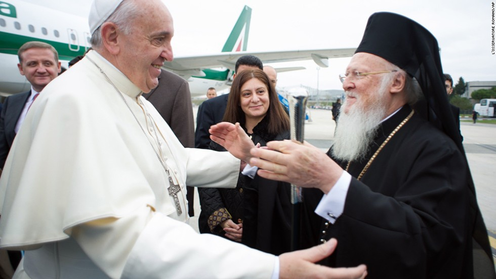 Pope Francis is welcomed by Ecumenical Patriarch Bartholomew I at the Istanbul Ataturk airport on November 29.