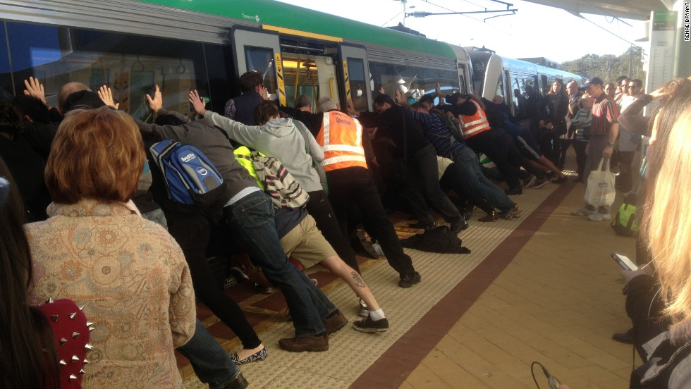 <strong>August 6:</strong> Dozens of commuters in Perth, Australia, work to rescue a man who got his leg trapped between a train and the platform. The passenger was able to wriggle free with their help.