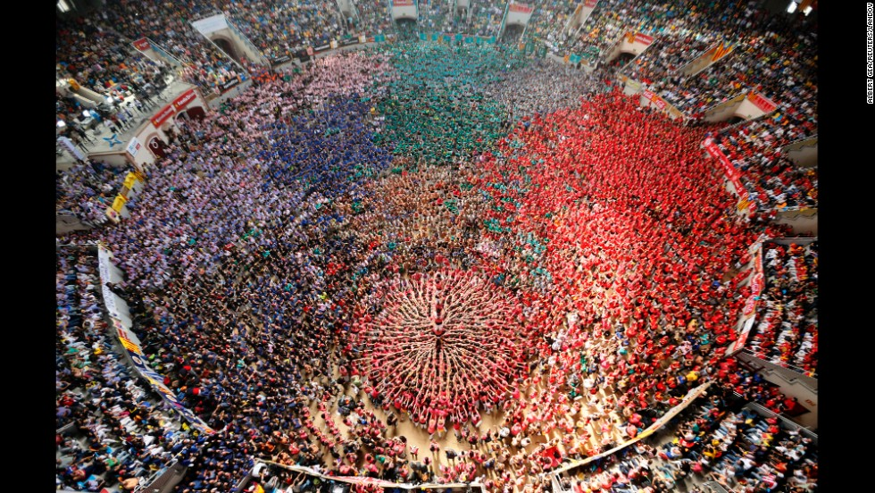 <strong>October 5:</strong> People form a human tower called a castell during a biannual competition in Tarragona, Spain. The formation of human towers is a tradition in Spain's Catalonia region.