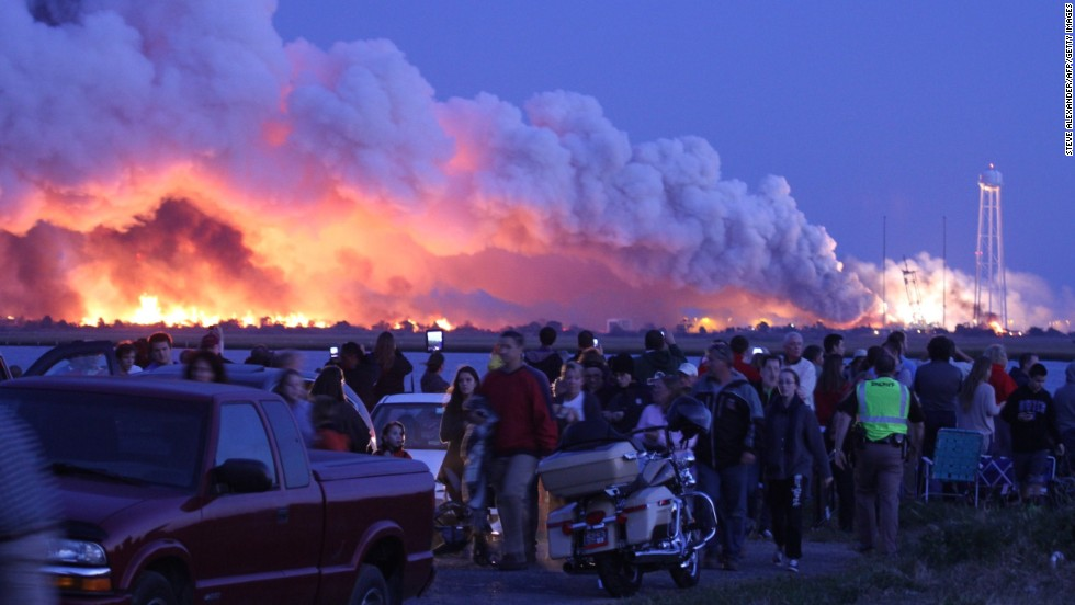 "<strong>October 28:</strong> People who came to Wallops Island, Virginia, to watch the launch of a NASA-contracted rocket walk away after <a href=""http://www.cnn.com/2014/10/29/us/gallery/antares-explosion/index.html"">the unmanned spacecraft, owned by Orbital Sciences Corp., exploded.</a> The cargo module was carrying 5,000 pounds of supplies and experiments meant for the International Space Station. No one was injured in the explosion, and the cause is under investigation."