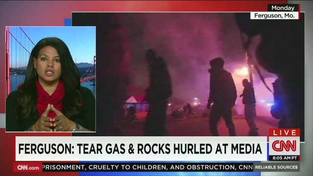 Ferguson.Media.face.tear.gas.rocks_00045010.jpg