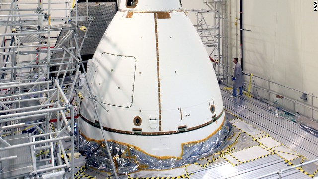 Orion is wrapped in protective panels before being moved to the launch pad on November 10.