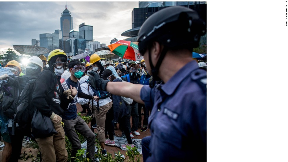 Protesters and police spar in Hong Kong