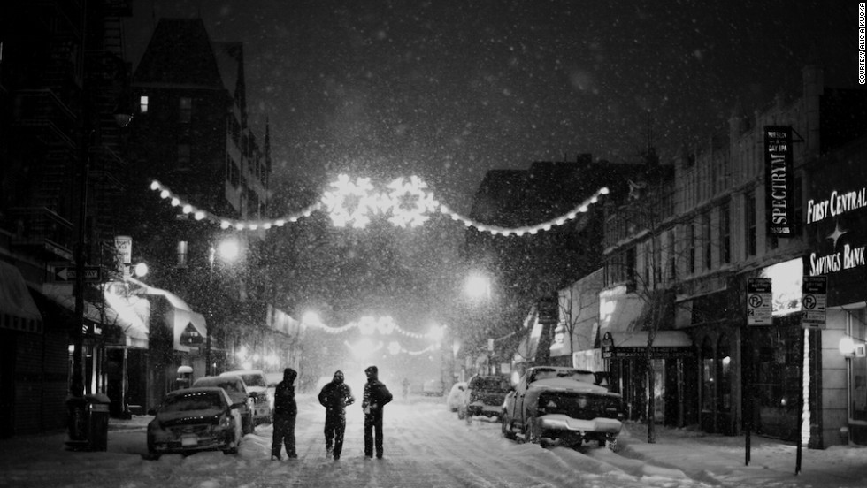 "<a href=""http://ireport.cnn.com/docs/DOC-1077804"">Alicia Kwoka </a>captured this shot in January of pedestrians in the streets of Queens in the midst of a steady snowfall. Kwoka said the peaceful street was a stark contrast to the usually busy New York environment."