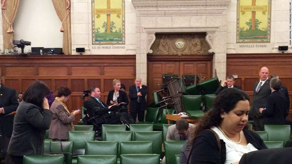 "<strong>October 22:</strong> In this photo provided by Canadian politician Nina Grewal, members of Canada's Parliament barricade themselves in a meeting room after shots were fired on Parliament Hill in Ottawa. <a href=""http://www.cnn.com/2014/10/22/world/gallery/canada-shooting-parliament/index.html"">A Canadian soldier was fatally shot at the National War Memorial nearby,</a> police said, and the alleged gunman was killed."