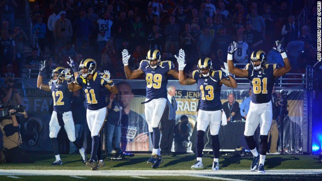 St. Louis Rams wide receiver Stedman Bailey (12) and wide receiver Tavon Austin (11) and tight end Jared Cook (89) and wide receiver Chris Givens (13) and wide receiver Kenny Britt (81) put their hands up to show support for Michael Brown before a game against the Oakland Raiders at the Edward Jones Dome.