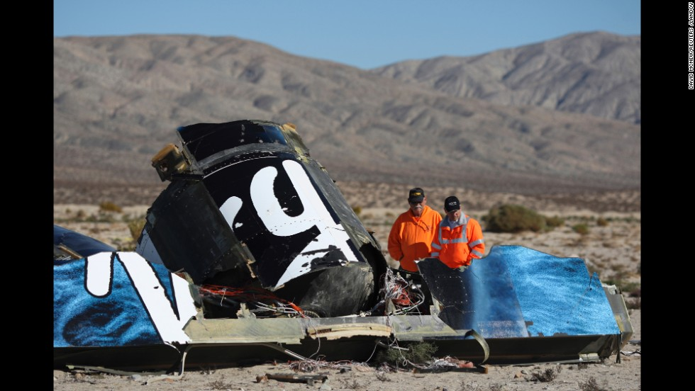 "<strong>November 2:</strong> Sheriff's deputies near Cantil, California, look at the wreckage of Virgin Galactic's SpaceShipTwo. <a href=""http://www.cnn.com/2014/11/02/us/spaceshiptwo-incident/"">The space plane disintegrated in the air</a> just two minutes after it separated from the jet-powered aircraft that carried it aloft. The accident killed co-pilot Michael Tyner Alsbury and injured co-pilot Peter Siebold, who managed to parachute to the ground."