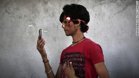 A participant takes a selfie during Delhi Queer Pride Parade, an event promoting gay, lesbian, bisexual and transgender rights, in New Delhi November 30, 2014. Hundreds of participants on Sunday took part in a parade demanding freedom and safety of their community, according to a media release.