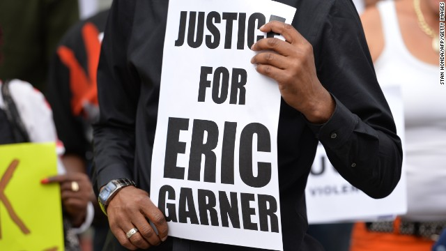 Demonstrators rally against police brutality in memory of Eric Garner on Staten Island in 2014.