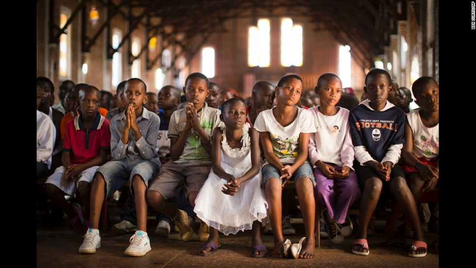 "<strong>April 6:</strong> Children pray at a Catholic church in Kigali, Rwanda. Twenty years ago, <a href=""http://cnnphotos.blogs.cnn.com/2014/04/03/like-being-in-the-valley-of-death/"">mass killings began</a> in Rwanda. An estimated 800,000 civilians, mostly from the Tutsi ethnic group, were murdered over a period of about 100 days."
