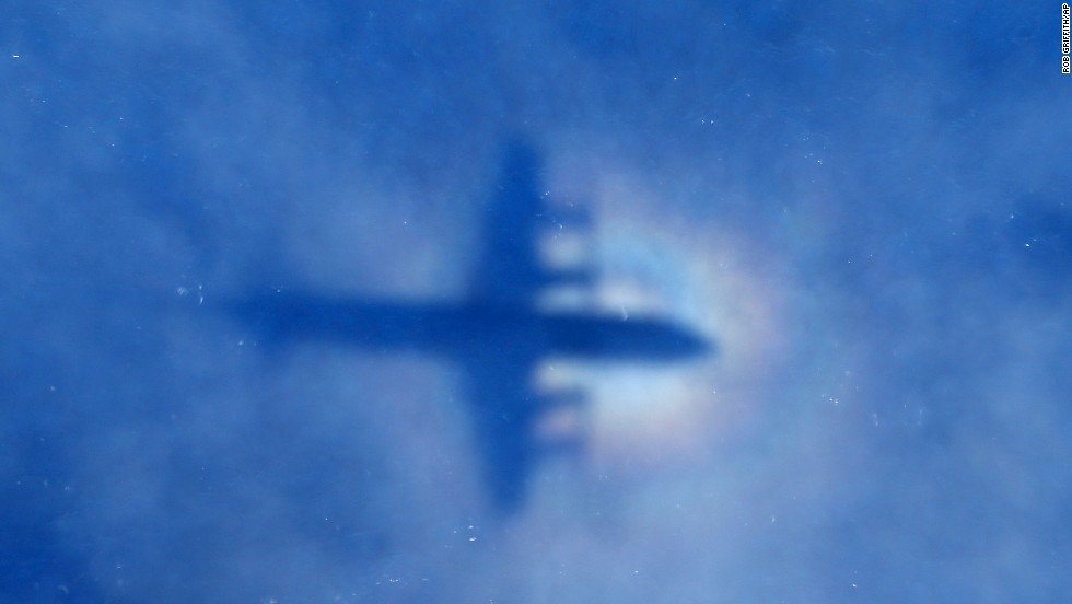 <strong>March 31:</strong> The shadow of a Royal New Zealand Air Force plane can be seen on low-level clouds as the plane flies over the southern Indian Ocean. Authorities combed thousands of square miles looking for Malaysia Airlines Flight 370, which disappeared March 8. Its whereabouts are still unknown.