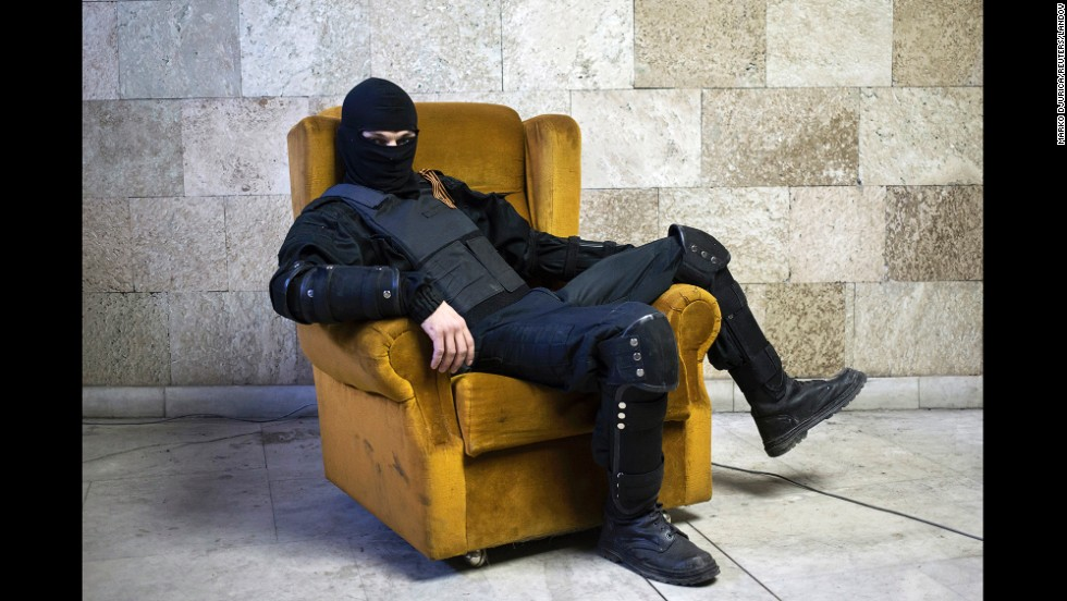 "<strong>April 25:</strong> A pro-Russian rebel poses for a picture inside a regional government building in Donetsk, Ukraine, on Friday, April 25. <a href=""http://www.cnn.com/2014/08/07/europe/gallery/ukraine-crisis/index.html"">Fighting between Ukrainian troops and pro-Russian rebels in the country</a> has left more than 3,000 people dead since mid-April, according to the United Nations."