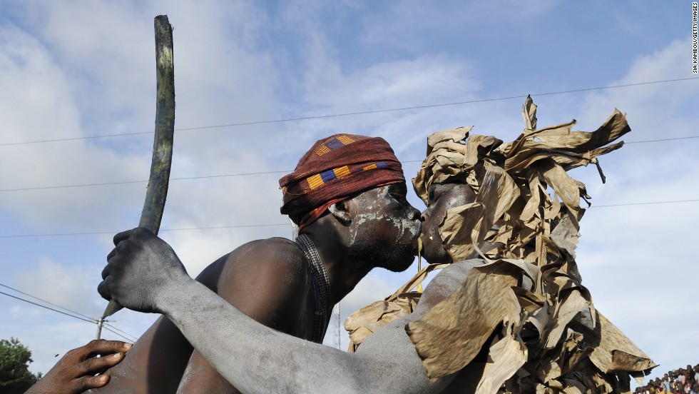 <strong>May 3:</strong> Youths from the Aboure tribe perform a warrior dance as they take part in a parade on the last day of the Popo carnival in Bonoua, Ivory Coast. This year's festival promoted national reconciliation.