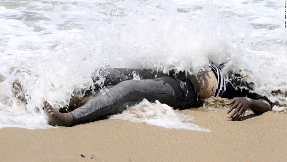 "<strong>May 14:</strong> The body of an illegal migrant lies on the shore of al-Qarboli, Libya. Libyan officials said at least 40 people died and around 50 were rescued when <a href=""http://www.cnn.com/2014/05/11/world/meast/libya-boat-migrants/index.html"">a boat carrying mostly sub-Saharan migrants sank off the coast of Tripoli</a> on May 11."