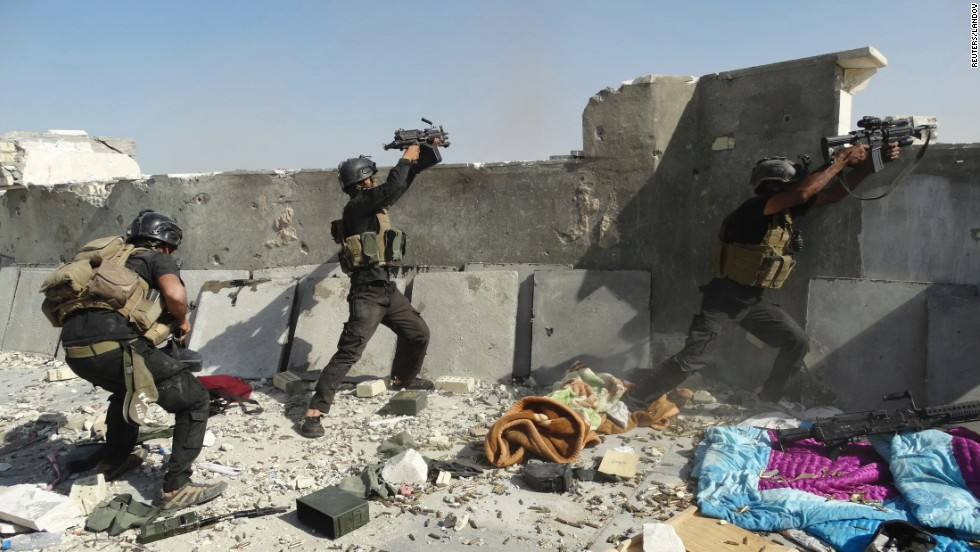 "<strong>June 19:</strong> Members of Iraq's Special Operations Forces take their positions during clashes with the ISIS militant group Thursday, June 19, in Ramadi, Iraq. ISIS <a href=""http://www.cnn.com/2014/06/13/world/gallery/iraq-under-siege/index.html"">has been advancing in Iraq and Syria</a> as it seeks to create an Islamic caliphate in the region."