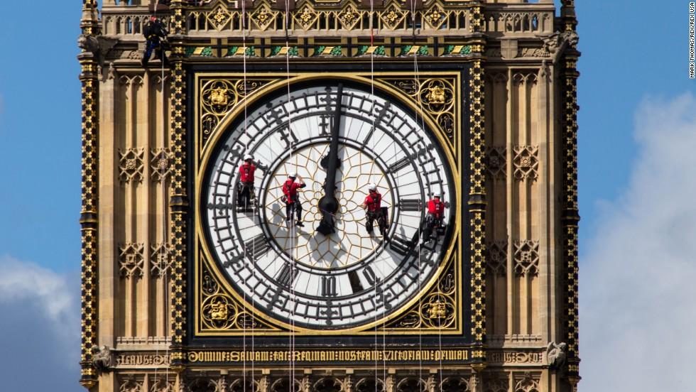 <strong>August 19:</strong> Workers clean the south face of Big Ben, the famous landmark at London's Palace of Westminster.