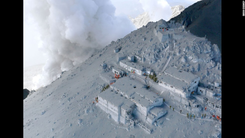 "<strong>September 28:</strong> Firefighters and members of Japan's military conduct a rescue operation at a cabin near the peak of Mount Ontake. Dozens of people were killed <a href=""http://www.cnn.com/2014/09/27/world/gallery/mount-ontake-erupts/index.html"">when the volcano erupted</a>."