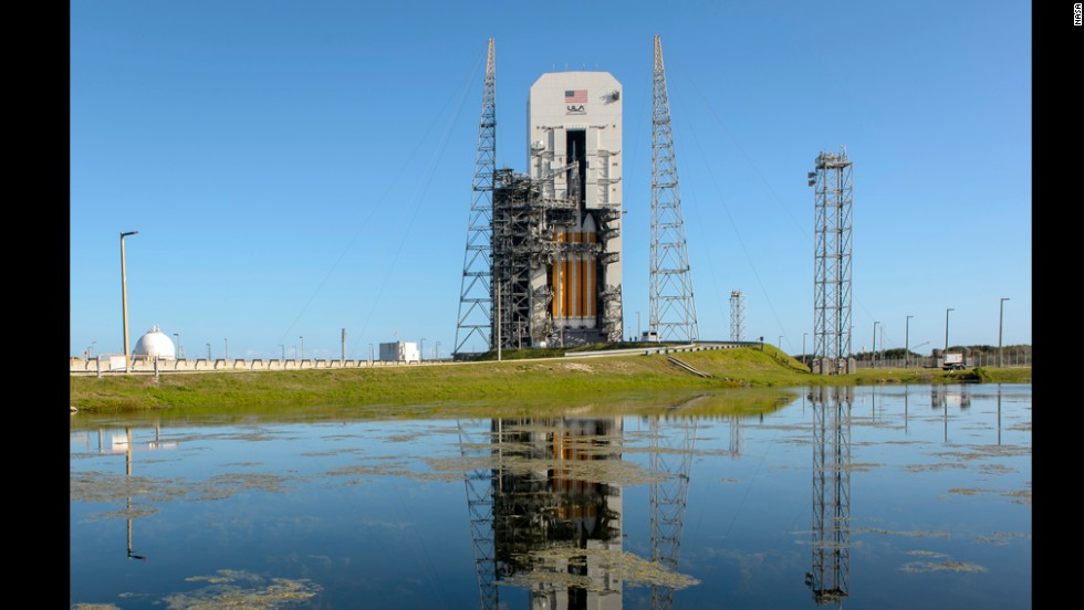 Orion sits on top of a Delta IV Heavy rocket on the launchpad at Cape Canaveral on Wednesday, December 3, waiting for its first test flight. Orion is designed to take humans to an asteroid and on to Mars, but its first flight will not carry a crew.