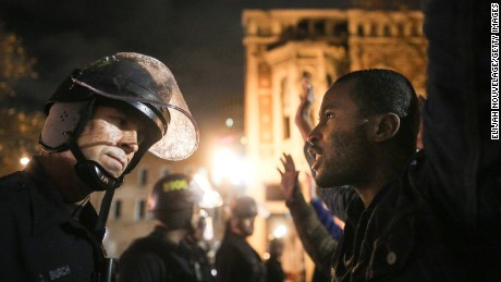 OAKLAND, CA - DECEMBER 3:  Protesters face off following a Staten Island, New York grand jury's decision not to indict a police officer in the chokehold death of Eric Garner on December 3, 2014 in Oakland, California. The grand jury declined to indict New York City Police Officer Daniel Pantaleo in Garner's death.  (Photo by Elijah Nouvelage/Getty Images)