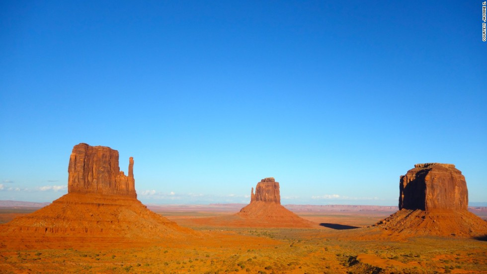 "The <a href=""http://ireport.cnn.com/docs/DOC-1180886"">Monument Valley Navajo Tribal Park</a>, located on the Arizona-Utah state line, is known for its towering sandstone formations and panoramic views."