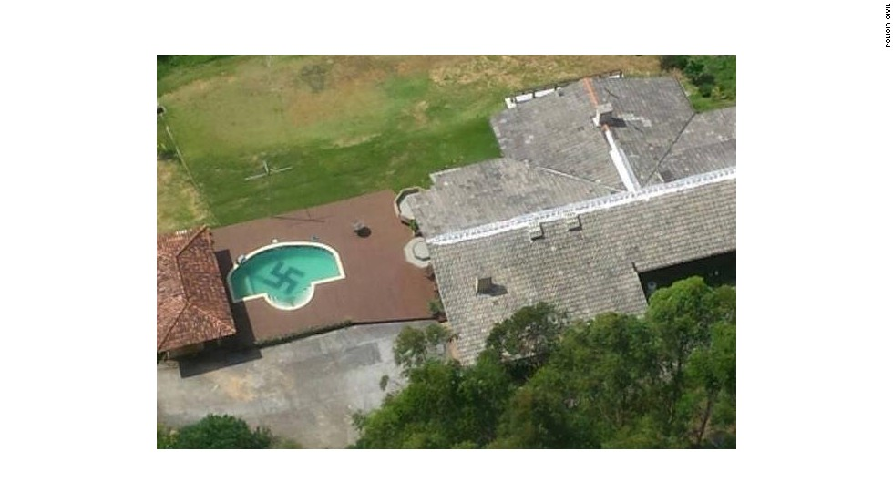 Police helicopter finds huge swastika in bottom of pool in Brazil