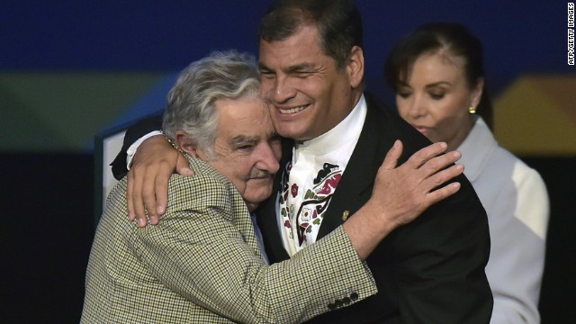 Uruguayan President Jose Mujica hugs his Ecuadorean counterpart Rafael Correa after being decorated during the UNASUR Summit, at the Eloy Alfaro Civic Centre in Guayaquil, Ecuador, on December 4, 2014. Leaders from South American bloc UNASUR are holding a summit aimed at increasing regional integration and boosting the 12-nation group's relevance three years after its launch. AFP PHOTO / RODRIGO BUENDIARODRIGO BUENDIA/AFP/Getty Images