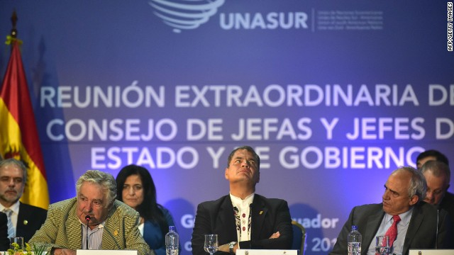 Uruguayan President Jose Mujica (L) delivers a speech after receiving the pro-tempore presidency of the UNASUR, next to Ecuador's President Rafael Correa (C) and the bloc's Secretary General Ernesto Samper, at the Eloy Alfaro Civic Centre in Guayaquil, Ecuador, on December 4, 2014. Leaders from South American bloc UNASUR are holding a summit aimed at increasing regional integration and boosting the 12-nation group's relevance three years after its launch. AFP PHOTO / RODRIGO BUENDIARODRIGO BUENDIA/AFP/Getty Images
