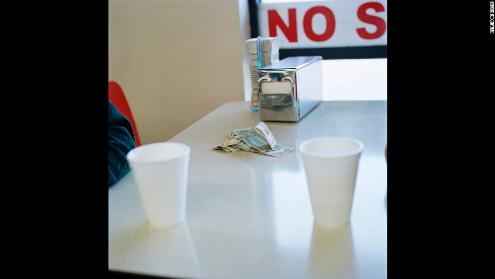 Money sits on the table after Herb Lindsay and Leon Mace finished their morning coffee at a nearby convenience store.