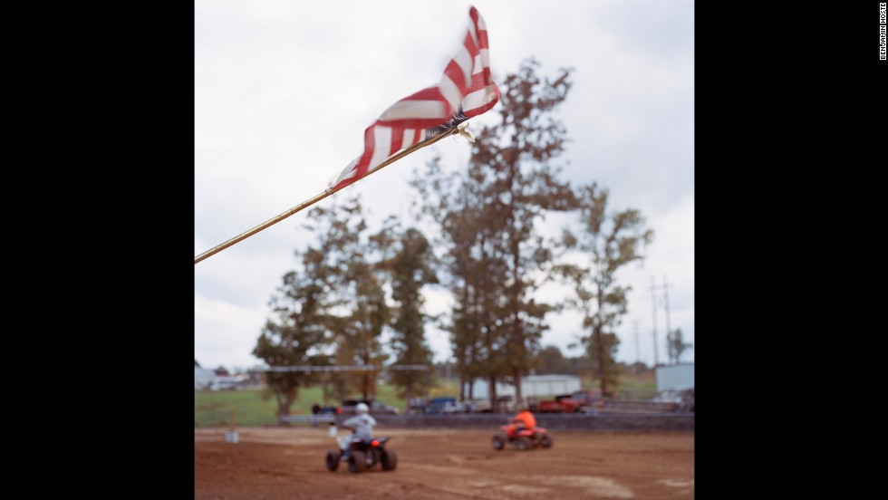 An American flag flaps in the wind during an ATV Rodeo in nearby Roby, Missouri.