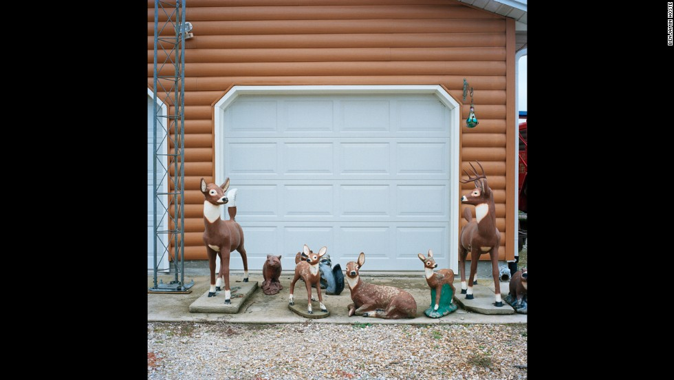 Ceramic lawn ornaments sit in front of Arrington's garage.
