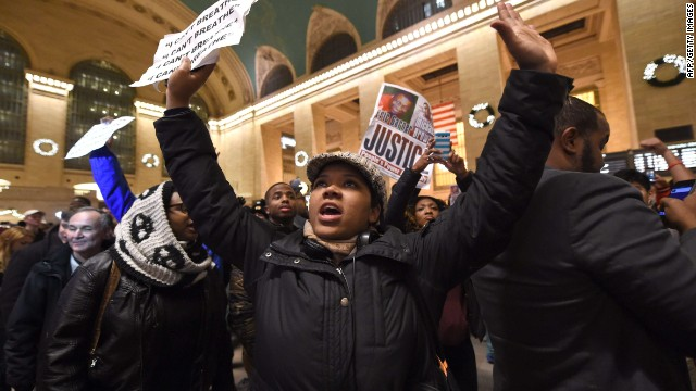 Protestors gather in New York Grand Central Station on December 3, 2014 after a grand jury decided not to charge a white police officer in the choking death of Eric Garner, a black man, days after a similar decision sparked renewed unrest in Missouri. Eric Garner died after being placed in a chokehold by New York police Officer Daniel Pantaleo while being arrested on suspicion of selling untaxed cigarettes in Staten Island. AFP PHOTO / Timothy A CLARYTIMOTHY A. CLARY/AFP/Getty Images