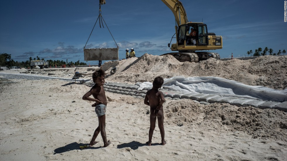 "The U.N.'s Intergovernmental Panel on Climate Change identified Kiribati as one of the six Pacific island nations that ""face a serious threat of permanent inundation from sea-level rise."" In a never-ending fight against the rising tides, both residents and their government construct seawalls to preserve the land."