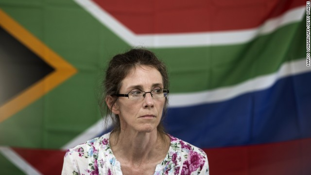 South African Yolande Korkie, a former hostage and wife of Pierre Korkie, holds a press conference in Johannesburg on January 16, 2014 to appeal for the release of her husband