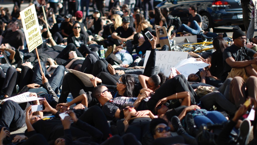 "People in Los Angeles lie down during a ""die-in"" on Hollywood Boulevard on December 6."