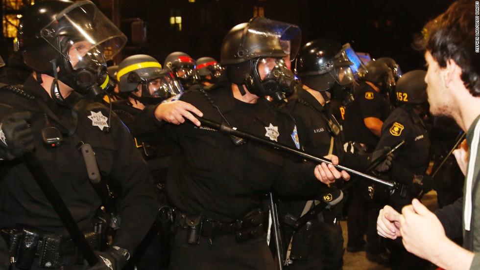 Anti-police demonstrators sing 'justice carols,' stage more die-ins