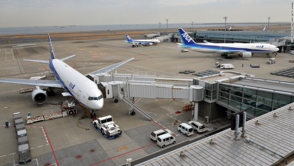 Tokyo's Haneda airport on January 16, 2013 after an ANA Dreamliner made an emergency landing. Smoke had been reported in the cockpit, which later turned out to be from an overheated battery. The Japanese incident and the Boston fire prompted a worldwide grounding of the entire Dreamliner fleet -- which numbered 50 aircraft at the time.